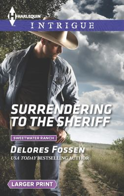 Mass Market Paperback Surrendering to the Sheriff [Large Print] Book