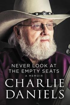 Hardcover Never Look at the Empty Seats: A Memoir Book