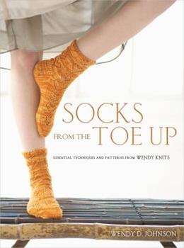 Socks from the Toe Up: Essential Techniques and Patterns from Wendy Knits 0307449440 Book Cover