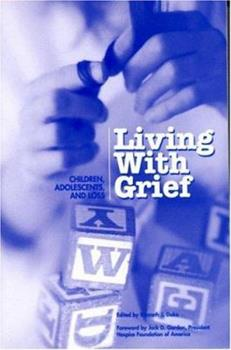 Paperback Living with Grief : Children, Adolescents and Loss Book