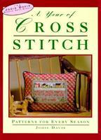 A Year of Cross-Stitch: Patterns for Every Season (Davis, Jodie, Jodie Davis Needle Arts School.) 156799217X Book Cover